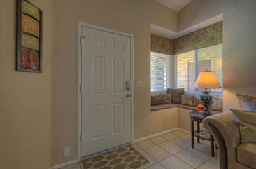 Entrance way includes a charming built-in window seat for relaxing with a good book or texting family and friends.
