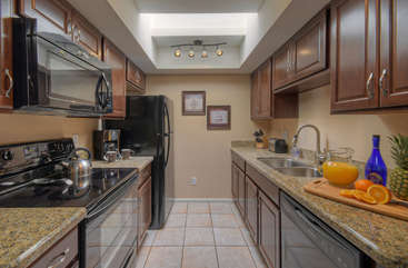 Everything you need to make delectable meals and mix exotic cocktails are found in this remodeled kitchen.