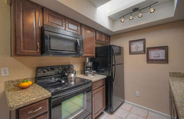 Bright kitchen with beautiful new cabinets and granite countertops will appeal to the chef.