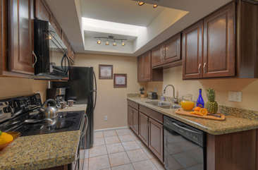 Fully stocked kitchen with new appliances makes meal preparation an efficient process.