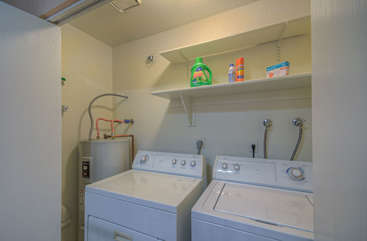 Washer and dryer behind closed doors off kitchen help you keep your wardrobe ready for the next adventure.