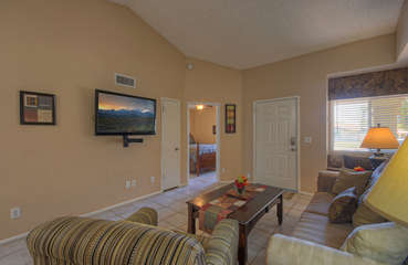Great room offers a cozy gathering area for watching large TV.