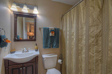 Upgraded west primary bath has a tub/shower combo.