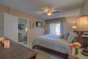 West primary suite has a deluxe king bed, walk-in closet and TV.