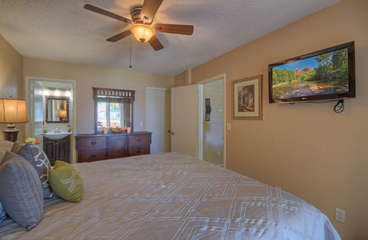 Ceiling fan and attractive decor create the perfect setting for sweet dreams.