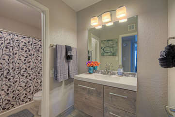Second bath with a walk-in shower has new floating vanity and additional improvements