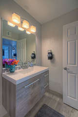 A new floating vanity, lights and tile floor enhance the appeal of the second bath