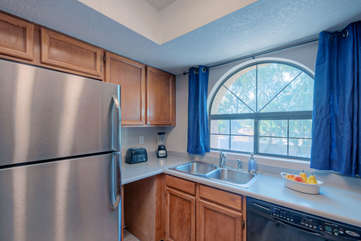 Window brightens kitchen with natural light and offers tempting views of the neighborhood and beyond