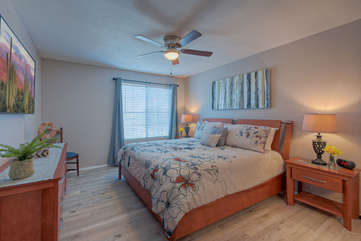 Spacious primary bedroom has king bed and Smart television to entertain you