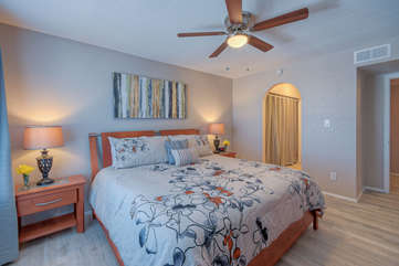 Ceiling fan, decor and tile floors add to comfort and appeal of the primary suite