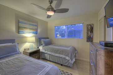 Second bedroom has 2 extended length twin beds, ceiling fan and a large TV