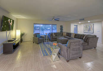 Great room has lots of comfortable seating for friendly conversations or watching large TV