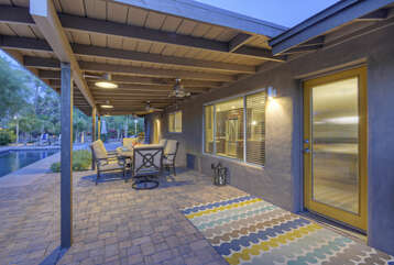 Covered porch offers a shady spot to relax and dine with your favorite peeps