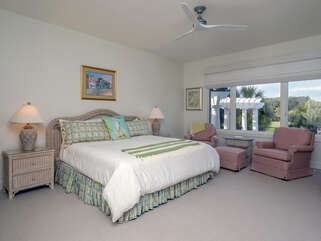 The 2nd BR has a king bed and TV. It has views of the pool and golf course.