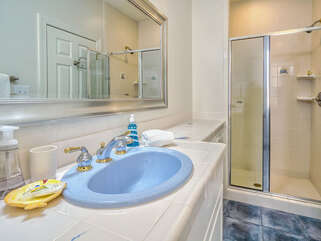 The full bath has a large vanity and walk in shower.