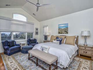 The master bedroom is on the second floor with a king bed, seating, & ocean views.