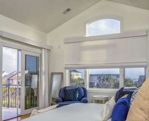 Sliding glass doors lead to the front balcony to relax with ocean view.