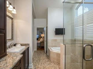 En Suite master bath with large soaker tub, separate shower, double sinks.