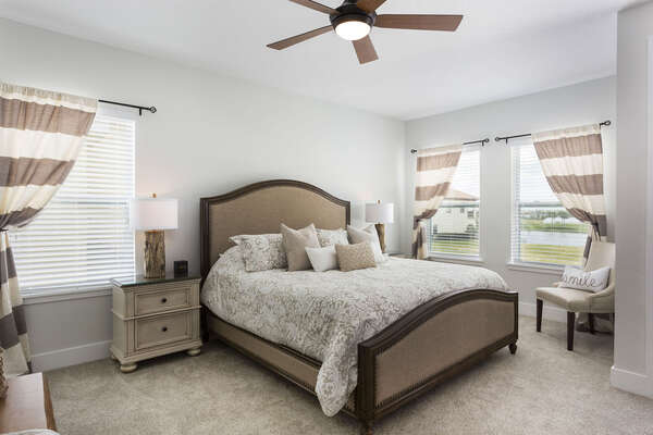 This master bedroom features a King bed, your own private balcony and beautiful rustic furnishings