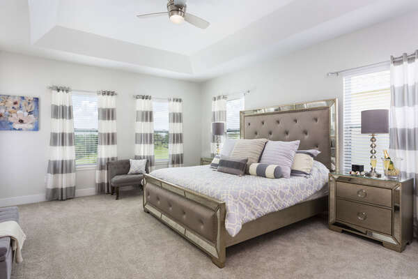 This upstairs master features a King bed in a oversized bedroom