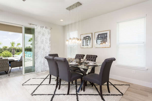 Formal dining for 6 with a beautiful bottle lighting above