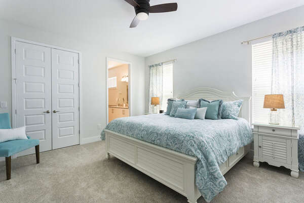 The downstairs master features a comfy King and beautiful blue furnishings