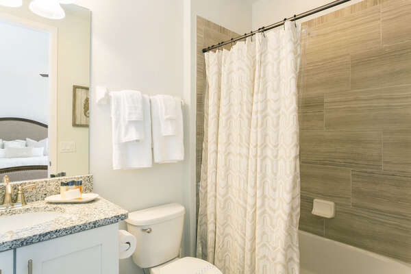 Ensuite bathroom featuring a tub shower combination