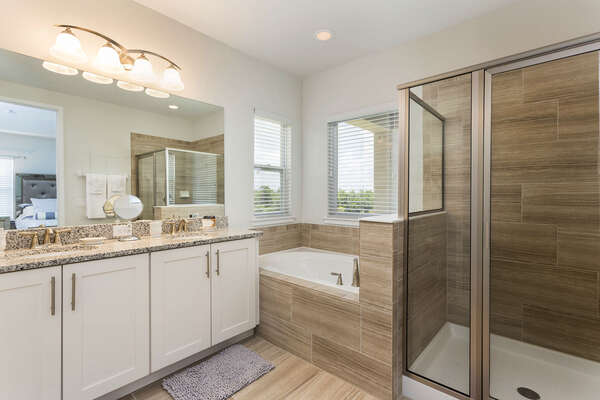 This bathroom features a tub and shower perfect for those who are looking to relax