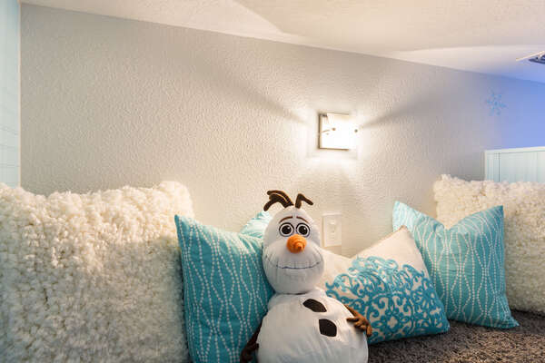 Olaf is waiting for the kids to come and hang out in this secret space