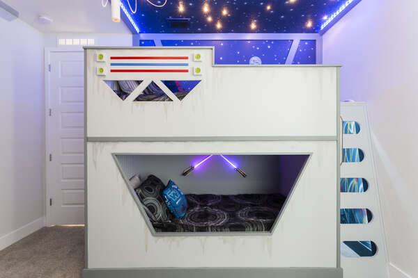 The kids will LOVE this incredible Star Wars bedroom with a custom designed bunk that lights up as you walk up the ladder