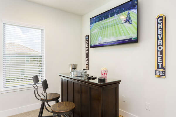 Make a few cocktails as the bar in the den as you put on some sports and cheer your team along
