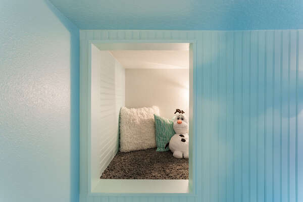 On the top bunk you can crawl over into your own secret den where the kids can play