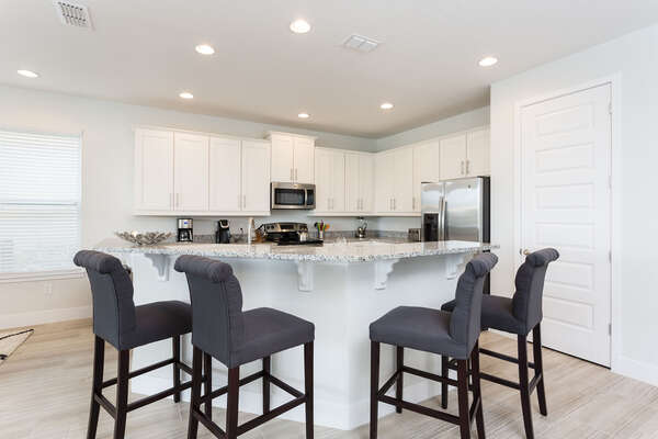 The kids can watch as you make pancakes in the morning in this kitchen complete with upgraded stainless steel appliances