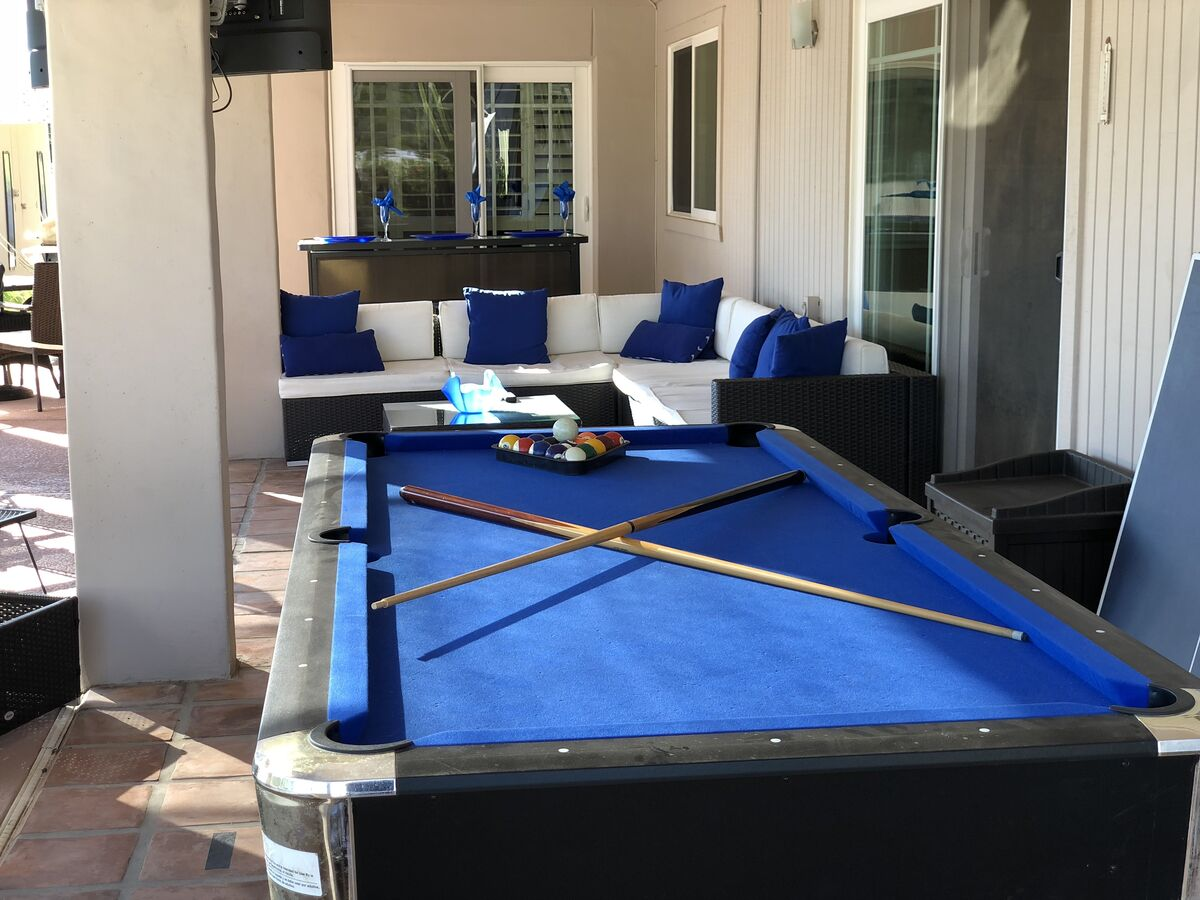 Convertible Billiard Table & Ping Pong Table Faces the Pool, Lounge Area and Outdoor Bar.