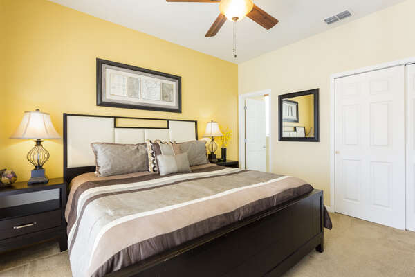 Return home to the comfort of this warm king bedroom