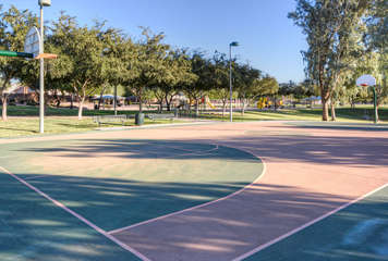Practice your 3 point shot on the neighborhood basketball court.