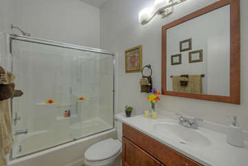 Second bathroom has a tub/shower combination and new vanity.