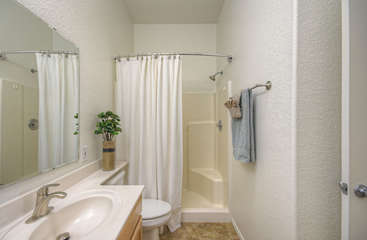 Upgraded primary bathroom has a walk-in shower.