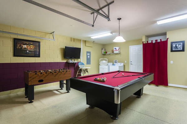Game room has pool table, Foosball, air hockey table, and a large screen TV