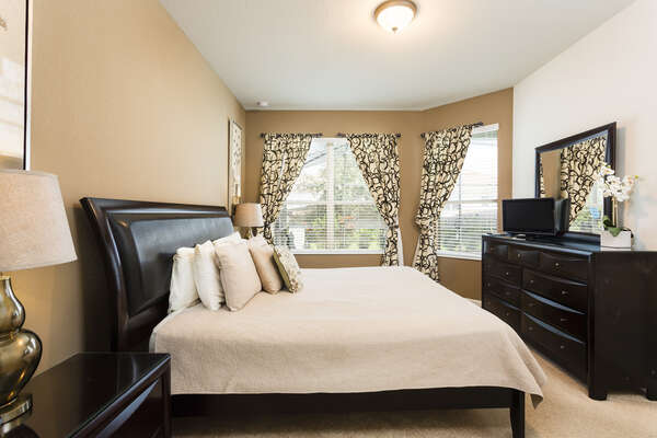 End your day in the comfort of this king bedroom