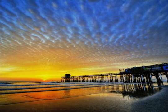 Watch sunsets from the pier.