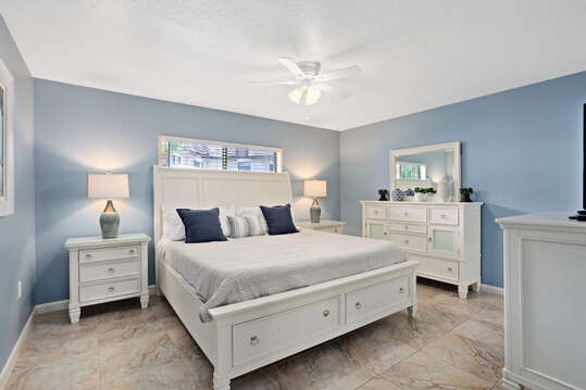 Serene master bedroom with a King Bed, flatscreen TV, ensuite and walk in closet.