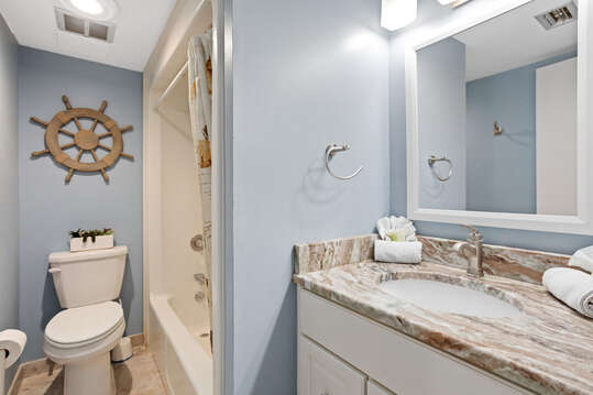Master ensuite with tub/shower and quartz counter.