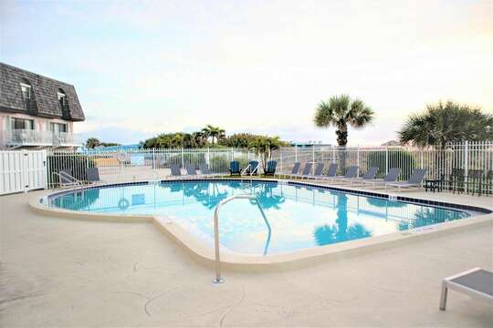Beautiful spacious oceanfront heated pool with a great view.