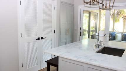 Behind the doors is a pantry. The sliding doors lead to a screened porch.