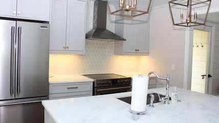 Features include new appliances, beautiful honed marble counters, and a soft green tile.
