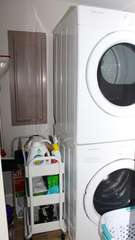 The laundry closet holds an HE washer and dryer.