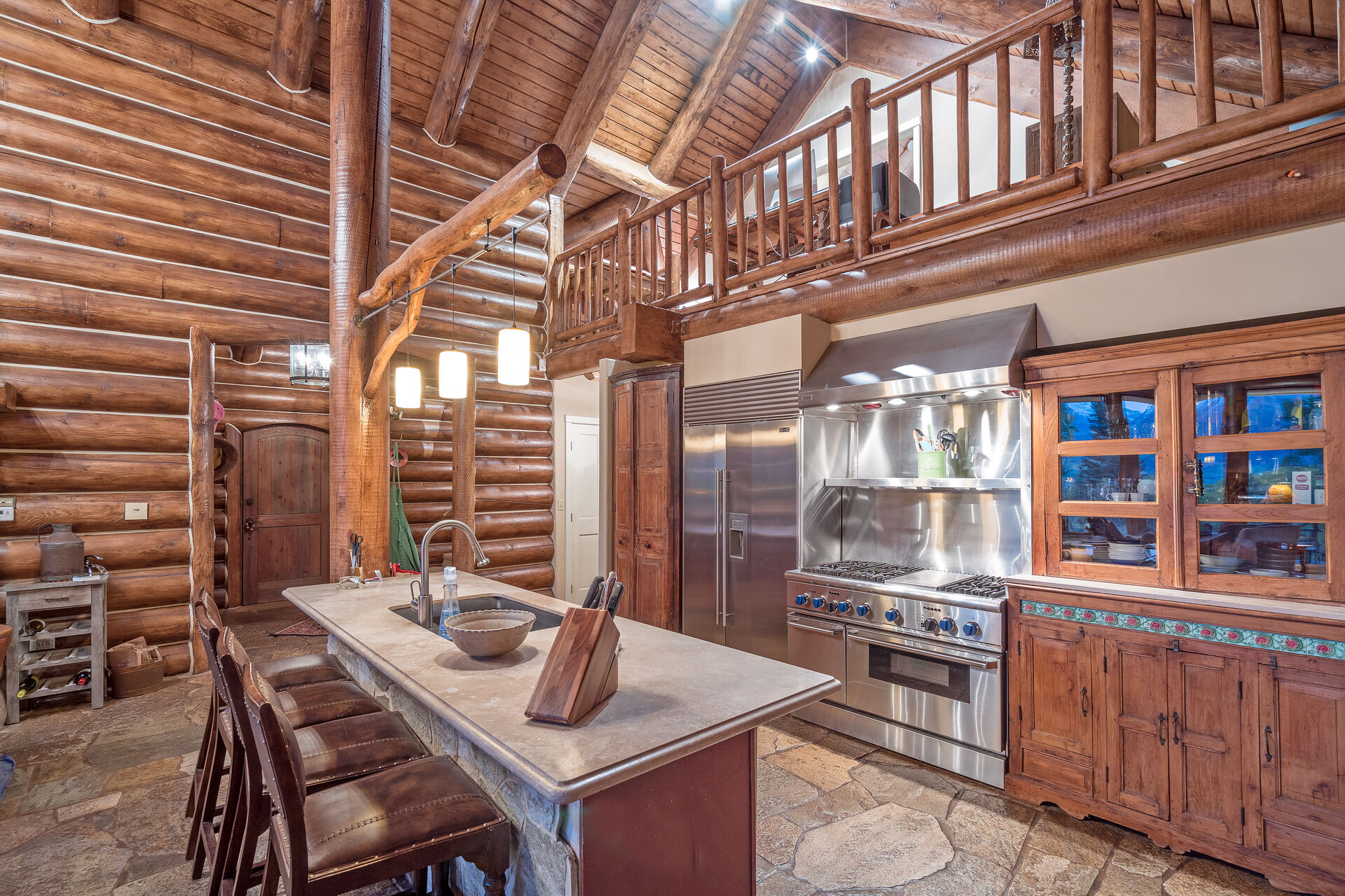 Full Kitchen with Chef Ready Stove and Views of the Loft