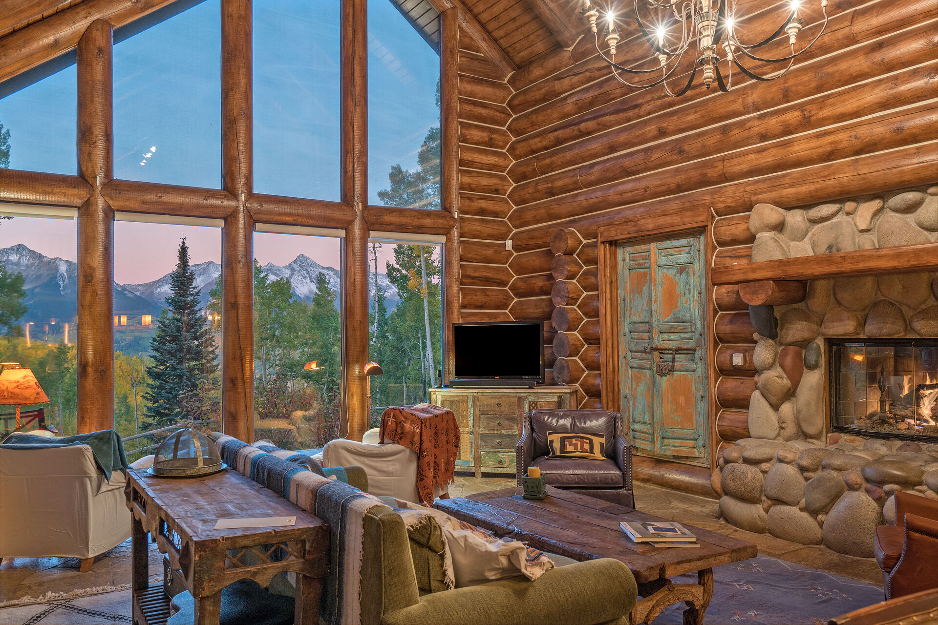 Large Windows with Views of the Forest and Mountains in the Living Area