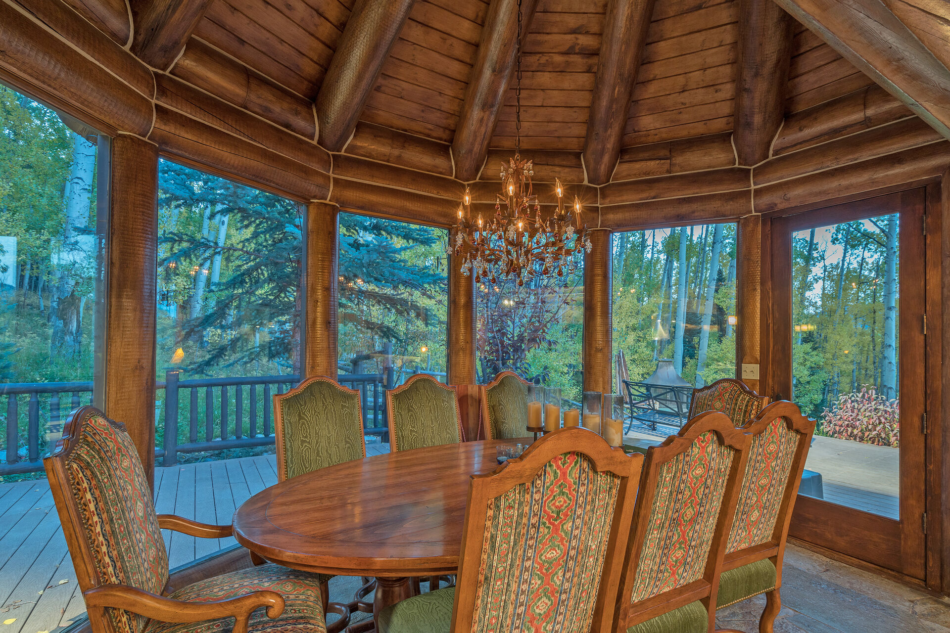 Dining Area for 8 Surrounded by Windows with Views of the Forest